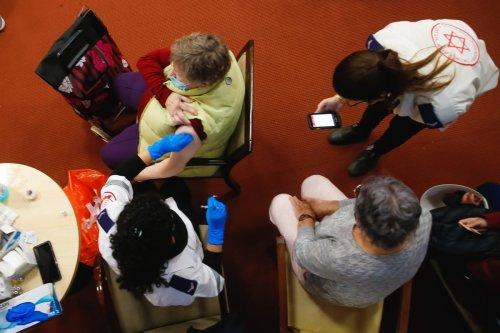 Elderly people receive a Pfizer-BioNTech coronavirus (COVID-19) vaccine at Mishan Efal Nursing Home, in Tel Aviv, Israel on 23 December 2020. [Nir Keidar - Anadolu Agency]