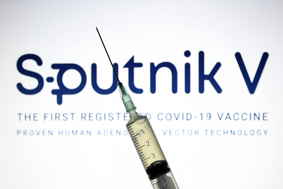 Sputnik V, (Gam-COVID-Vac), COVID-19 vaccine logo is displayed on a screen with a syringe in the front [Hakan Nural/Anadolu Agency]