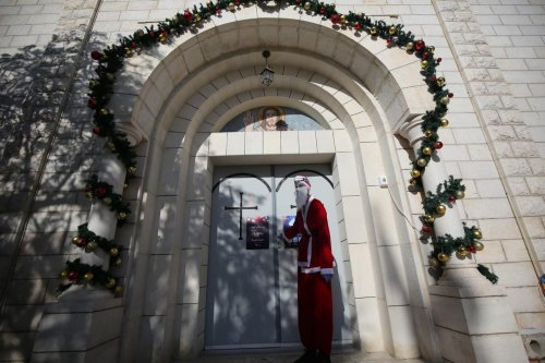 Christmas decorations on display outside a church in Gaza, 24 December 2020 [Mohammed Asad/Middle East Monitor]