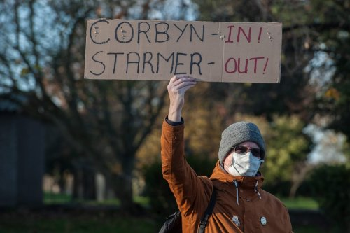 Members of the Labour Party march through Finsbury Park in support of Jeremy Corbyn and to demand that the whip is restored to him by leader Kier Starmer on 22 November 2020 in London, England. [Guy Smallman/Getty Images]