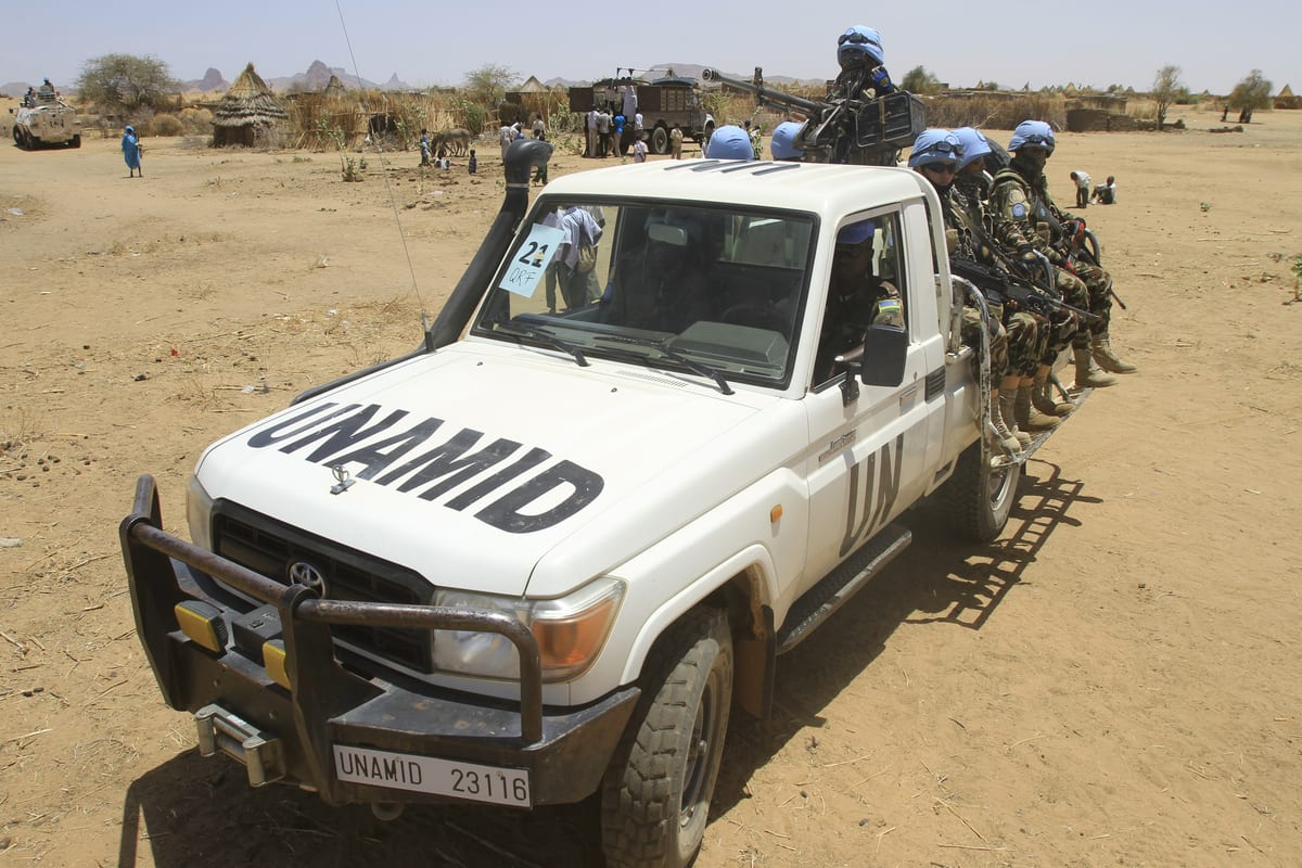 Peace-keepers with the United Nations-African Union Mission in Darfur (UNAMID) patrol the Shangil Tobaya area for displaced people in North Darfur state, on June 18, 2013 [ASHRAF SHAZLY/AFP via Getty Images]