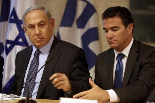 A file picture taken at the Israeli foreign ministry on October 15, 2015, shows Prime Minister Benjamin Netanyahu (L) sitting next to Yossi Cohen, who is currently the head of Israel's National Security Council, and who was named as the 12th head of the Mossad intelligence agency by Netanyahu on December 7, 2015. Cohen will take over from outgoing Mossad head Tamir Pardo, who will be leaving his post after five years next January. AFP PHOTO / GALI TIBBON / AFP / GALI TIBBON (Photo credit should read GALI TIBBON/AFP via Getty Images)