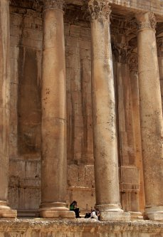 Tourists rest between to the columns of the Temple of Bacchus in the Roman acropolis in the historical city of Baalbeck in the Bekaa valley on July 23, 2008 [HASSAN AMMAR/AFP via Getty Images]