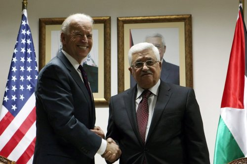 RAMALLAH, WEST BANK, MARCH 10: US Vice President Joe Biden (L) and Palestinian President Mahmoud Abbas shake hands during their meeting at the Presidential compound on March 10, 2010 in Ramallah, West Bank. American Vice-President Joe Biden is in the Middle East to meet Palestinian and Israeli leaders, including Palestinian President Mahmoud Abbas, Israeli Prime Minister Benjamin Netanyahu and Israeli President Shimon Peres, before travelling to Jordan on Thursday March 11. (Photo by Atef Safadi - Pool/Getty Images)