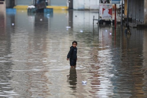 Flooded street caused by heavy rainfall in Gaza City, Gaza on 17 December 2020 [Ali Jadallah/Anadolu Agency]