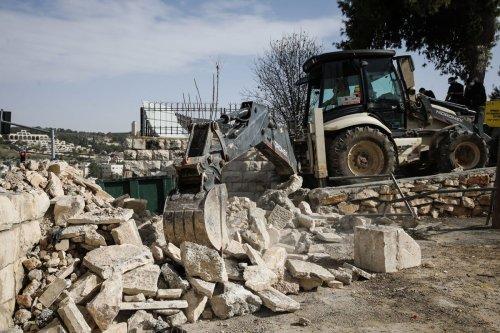 Israeli soldiers demolished an Islamic cemetery in Jerusalem on 14 December 2020 [Mostafa Alkharouf/Anadolu Agency]