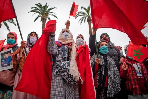 Moroccans celebrate after the US adopted a new official map of Morocco that includes the disputed territory of Western Sahara in Rabat, Morocco on 13 December 2020 [FADEL SENNA/AFP/Getty Images]