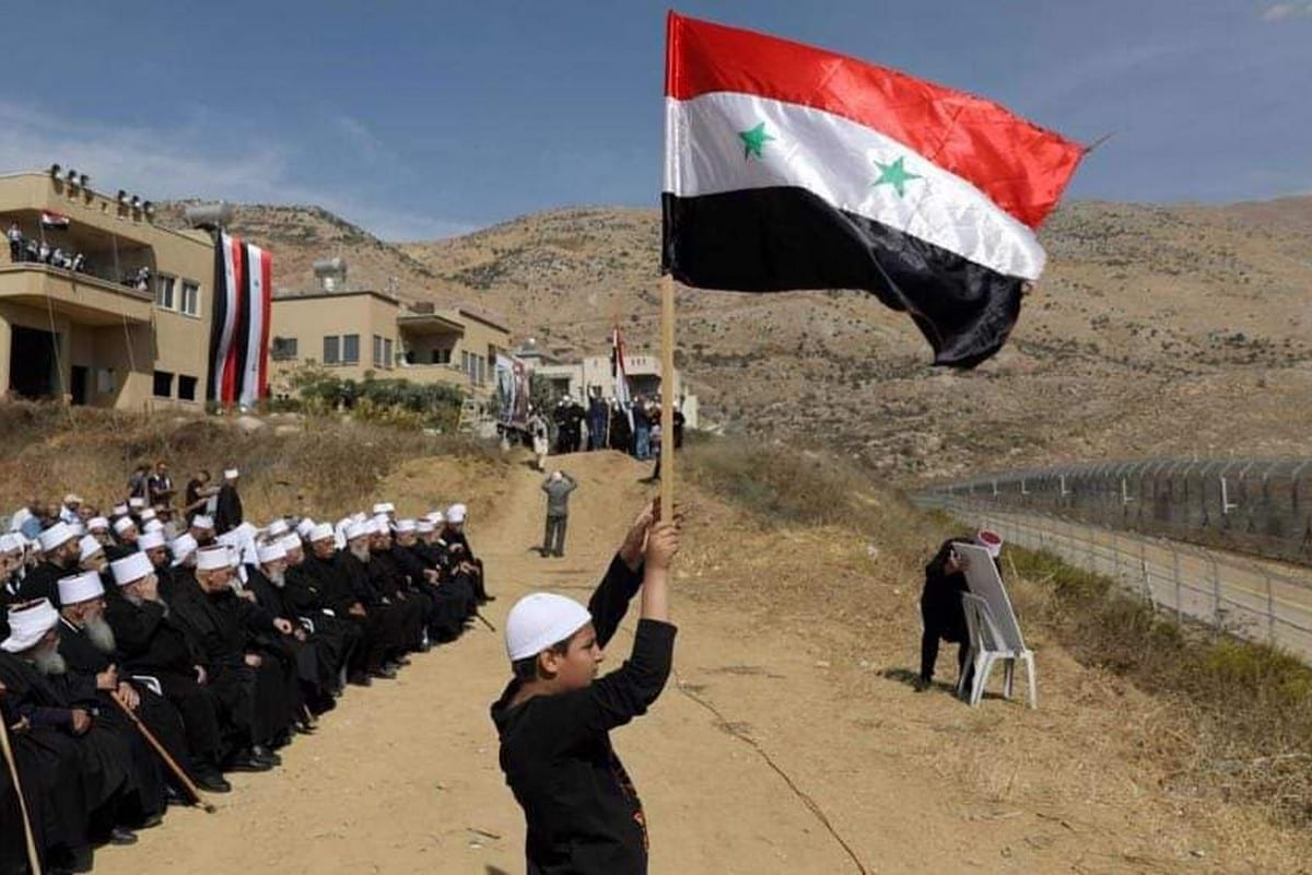 Syrians in the occupied Golan Heights protest against Israel's plans to install wind turbines on their agricultural land, 9 December 2020 [jamlyyyyy/Twiter]
