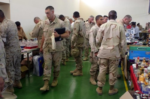 US Military personnel shop for merchandise during the bi-weekly bazaar held at Ahmed Al Jaber Air Base (AB), Kuwait, during Operation IRAQI FREEDOM on 25 August 2003 [PICRYL]