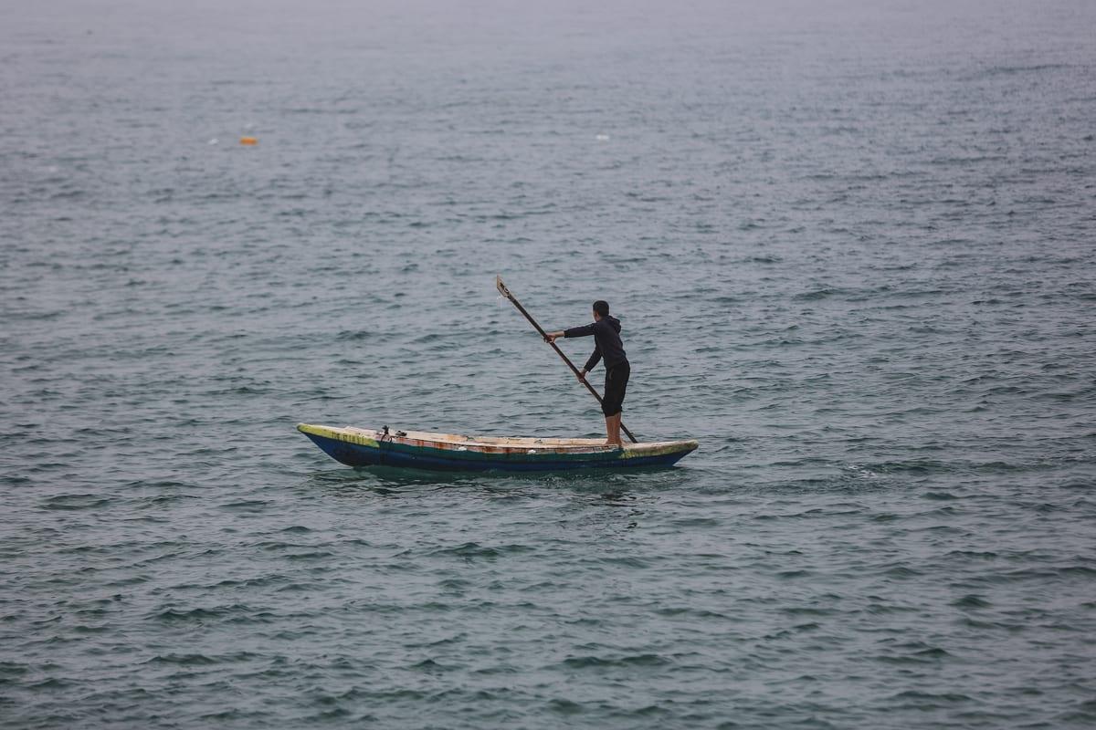 Gazaian fishermen sail to the sea at the Port of Gaza in Gaza City, Gaza on January 5, 2021. [Ali Jadallah - Anadolu Agency]
