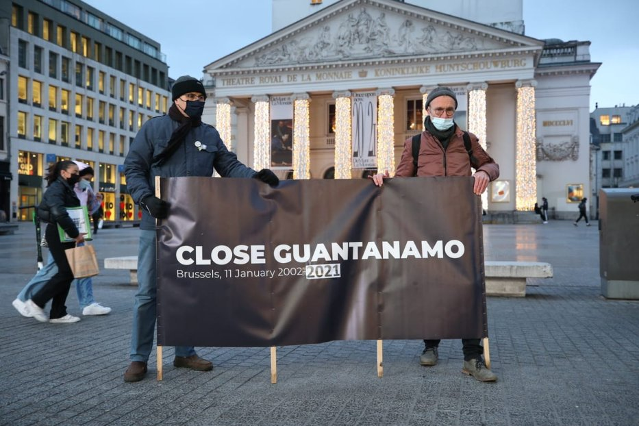 People hold a banner during a protest to demand for the closure of Guantanamo on the 19th anniversary of its opening in Brussels City Center, Belgium, on January 11, 2021 [Dursun Aydemir/Anadolu Agency]