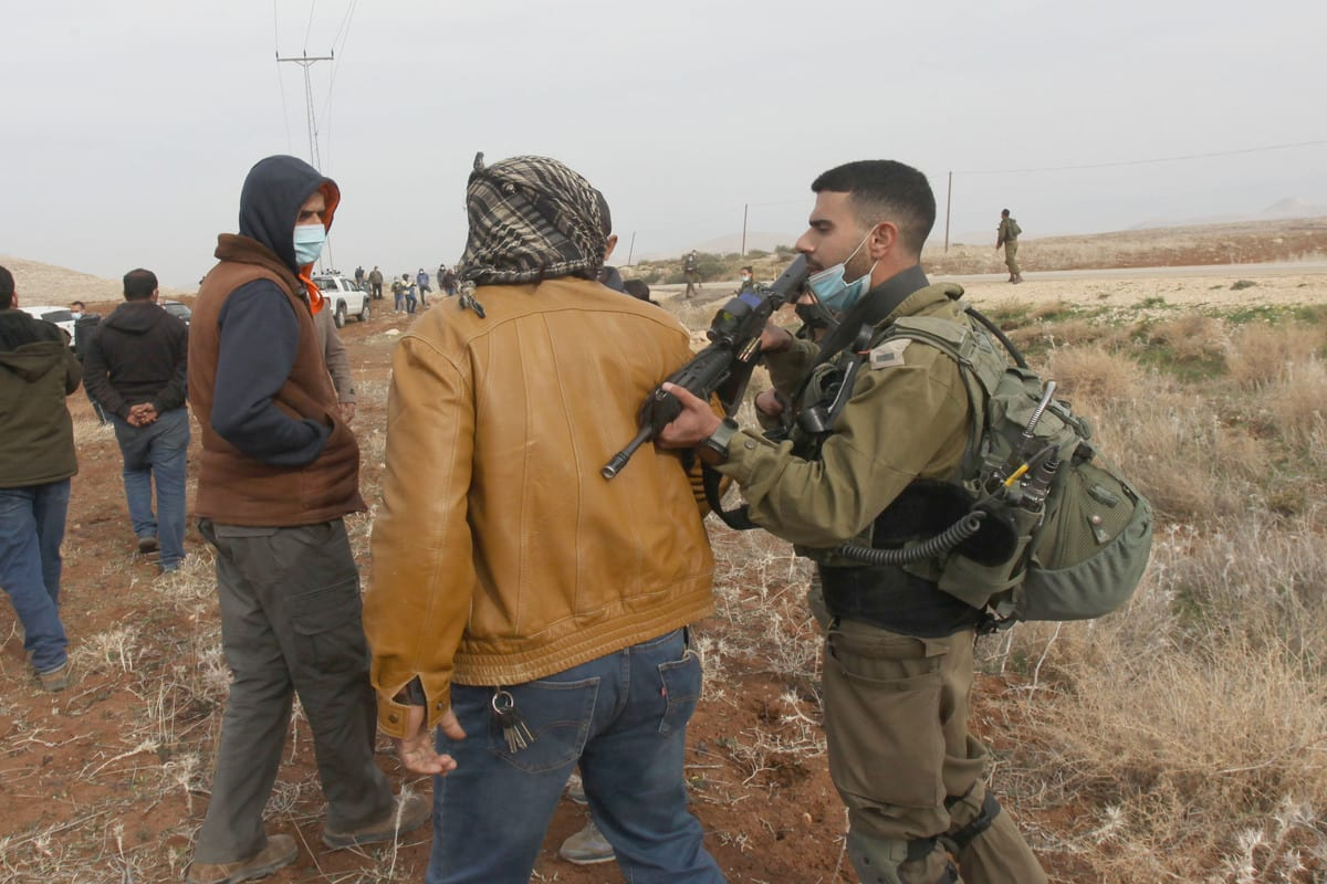 Israeli forces prevent Palestinian farmers who are trying to reach agricultural lands in village of Aqraba, Nablus, West Bank on West Bank on January 13, 2021 [Nedal Eshtayah/Anadolu Agency]