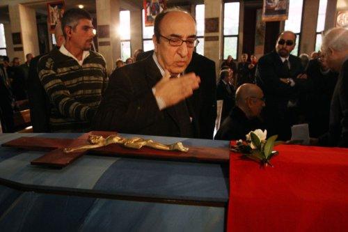 Lebanese musician Elias Rahbani bids farewell to his late brother, composer Mansour Rahbani on January 16, 2009 [ANWAR AMRO/AFP via Getty Images]