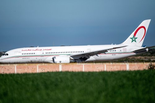 """This picture taken on February 2, 2020 shows a Royal Air Maroc (RAM) Boeing 787-8 """"Dreamliner"""" aircraft landing at Morocco's Benslimane airport, reportedly carrying repatriated Moroccan citizens from China's Wuhan province following the outbreak of the SARS-like """"Wuhan coronavirus"""" (novel coronavirus 2019-nCoV). (Photo by FADEL SENNA / AFP) (Photo by FADEL SENNA/AFP via Getty Images)"""