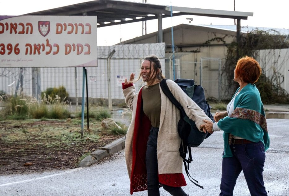 "Hallel Rabin (L), a 19-year-old Israeli conscientious objector, walks with her mother Irit Rabin outside the ""number six"" military prison near Atlit in northern Israel on November 20, 2020, upon release from jail for refusing to serve in the Israeli army. - Army service is compulsory for most Israeli citizens and while many seek exemptions on various grounds -- some arguably less than truthful -- Rabin's case is unusual in that she openly declared herself to be a pacifist and served prison time. Hallel had served a total of 56 days since August at the grim military prison ""number six"", and was facing up to 80 more in detention. But after grilling her at four hearings, an army board finally accepted that her pacifism was sincere and not driven by ""political considerations,"" which would have landed her more prison time. (Photo by Emmanuel DUNAND / AFP) (Photo by EMMANUEL DUNAND/AFP via Getty Images)"