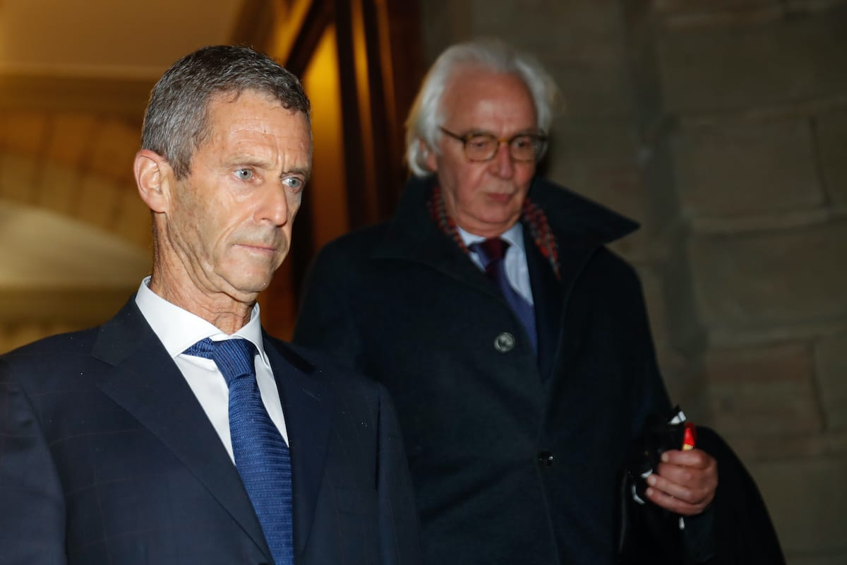 French-Israeli diamond magnate Beny Steinmetz (L) and his lawyer Marc Bonnant leave the courthouse after the verdict at the end of his trial over alleged corruption linked to mining deals in Guinea, in Geneva on 22 January 2021. [STEFAN WERMUTH/AFP via Getty Images]