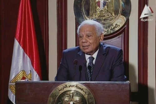Egypt's former prime minister Hazem El-Beblawi addressing the media in Cairo on 24 February 2014 [AFP/Getty Images]