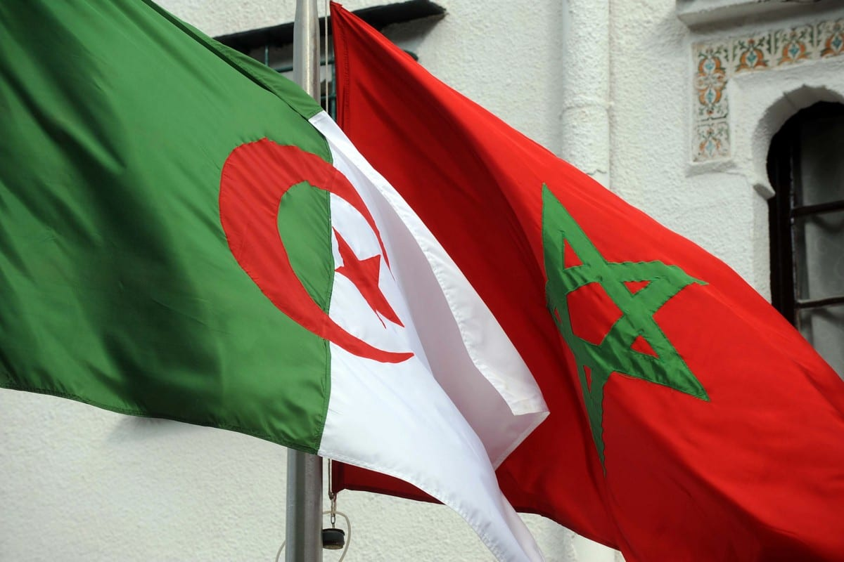 The flags of Algeria (L) and Morocco flutters in Algiers, Algeria on 24 January 2012 [FAROUK BATICHE/AFP/Getty Images]