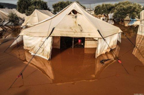 A flooded tents at the Harbanoush refugee camp after heavy rain caused floods in Idlib, Syria on January 19, 2021 [Izzeddin Idilbi/Anadolu Agency]