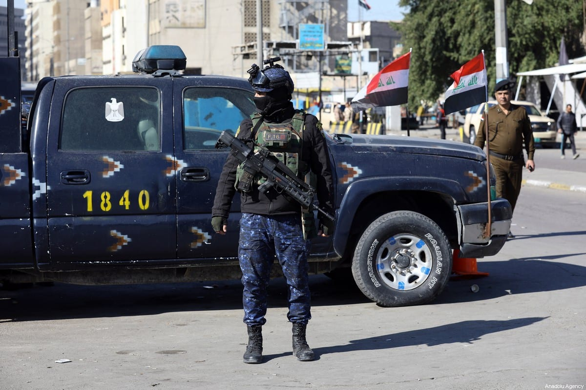 BAGHDAD, IRAQ - JANUARY 21: Security forces stand guard at the explosion site after a suicide bombing attack at al-Tayaran Square in Baghdad, Iraq on January 21, 2021. At least 28 people have been killed and 73 more wounded in a suicide bombing in Iraq's capital. ( Murtadha Al-Sudani - Anadolu Agency )