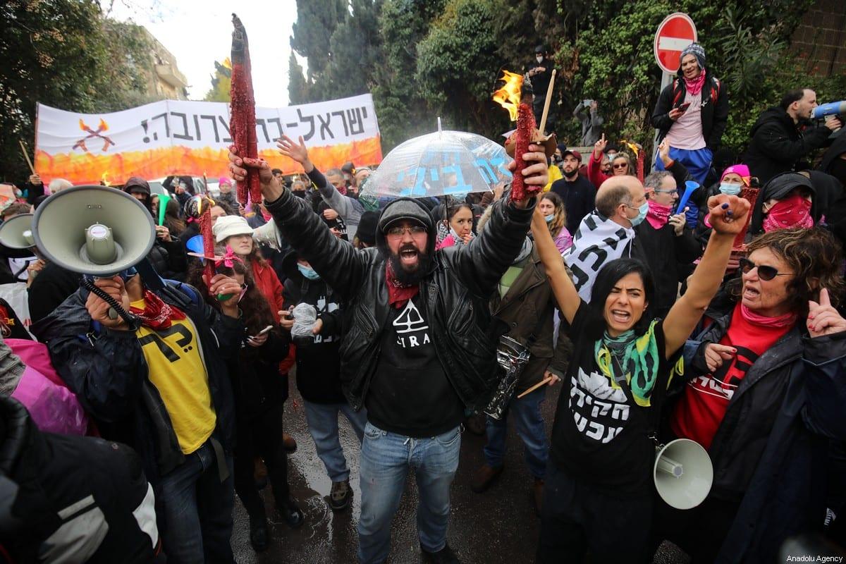 People gather to protest against the Israeli Prime Minister Benjamin Netanyahu in Western Jerusalem on January 29, 2021 [Mostafa Alkharouf/Anadolu Agency]