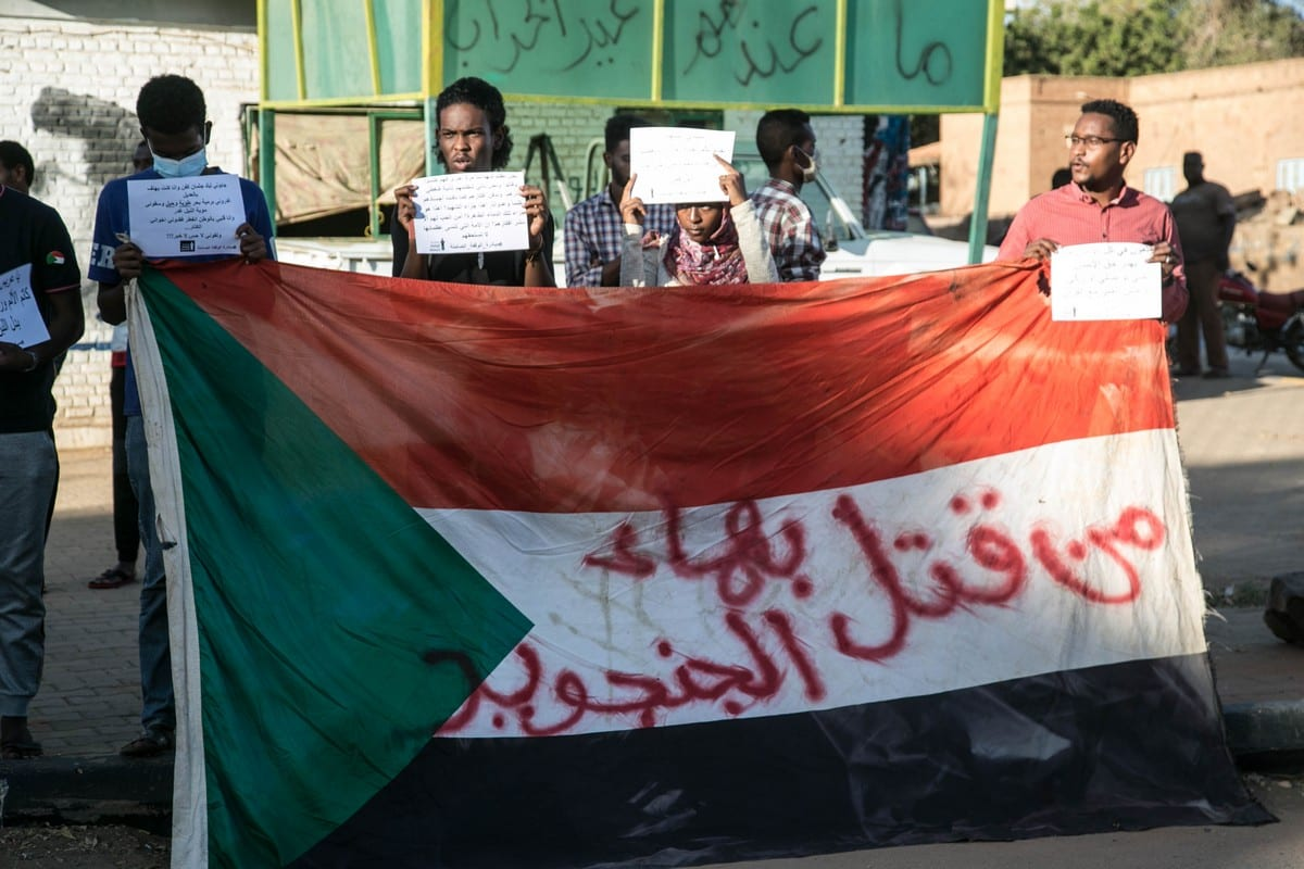 Families take part in a sit-in to pay tribute to killed anti-regime demonstrators in Khartoum, Sudan on 4 January 2021 [Mahmoud Hjaj/Anadolu Agency]
