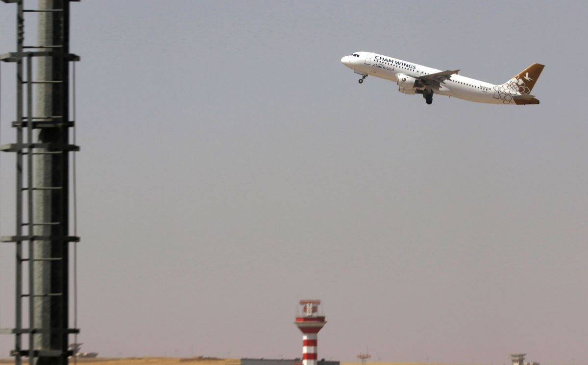A Cham Wings plane, a private Syrian airline, is pictured taking off from an airport [SAFIN HAMED/AFP via Getty Images