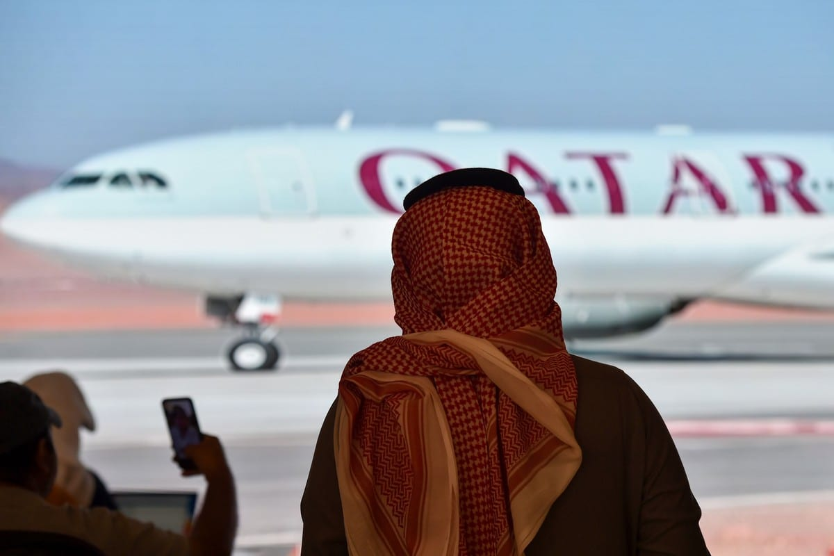Journalists watch the arrival of the Qatar envoy ahead of the 41st Gulf Cooperation Council (GCC) summit in Saudi Arabia on 5 January 2021 [FAYEZ NURELDINE/AFP/Getty Images]