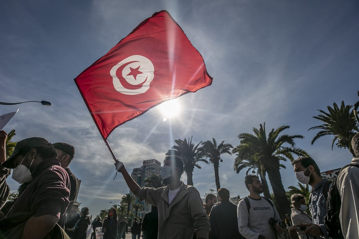 """Tunisian demonstrators gather at Avenue Mohammed V and march to Avenue Habib Bourguiba during a rally to protest against """"police repression"""" and demand the release of demonstrators detained in recent days in capital Tunis on January 30, 2021 [Yassine Gaidi / Anadolu Agency]"""