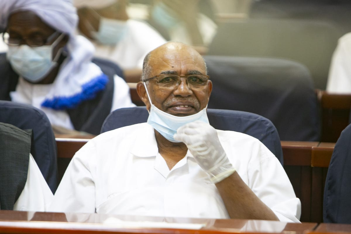 Sudan's ousted president Omar al-Bashir appears during his trial along with others over the 1989 military coup that brought them to power, at Special court established at the Officer Training Institute in the capital Khartoum on 2 February 2021. [Mahmoud Hjaj - Anadolu Agency]
