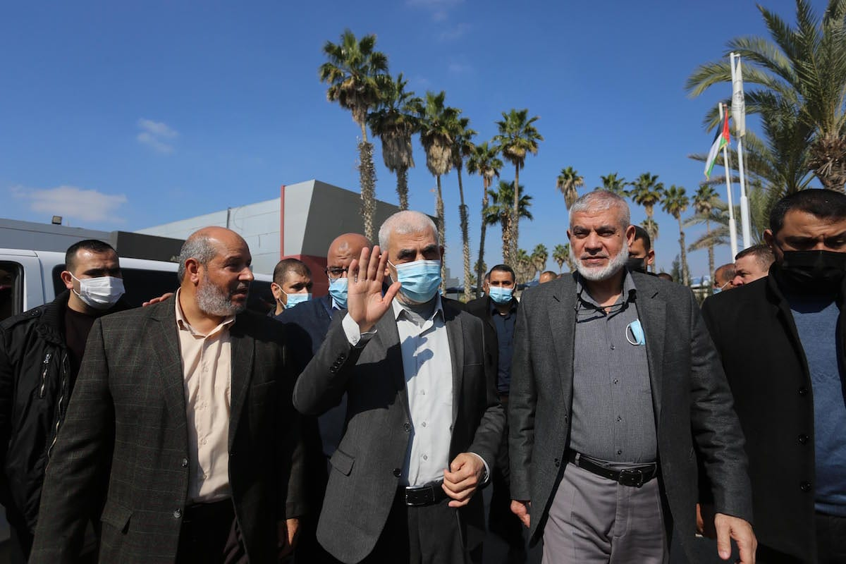 Hamas director Khalil al-Hayya (L) and Palestinian leader of Hamas in the Gaza Strip Yahya Sinwar (C) with the leaders of the Palestinian groups leave the city at the Rafah Border Gate in Gaza to attend the national dialogue talks scheduled to begin tomorrow in Cairo, the capital of Egypt. in Rafah, Gaza on 7 February 2021. [Ashraf Amra - Anadolu Agency]