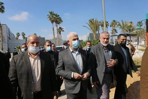Hamas director Khalil al-Hayya (L) and Palestinian leader of Hamas in the Gaza Strip Yahya Sinwar (C) in Rafah, Gaza on February 07, 2021 [Ashraf Amra/Anadolu Agency]