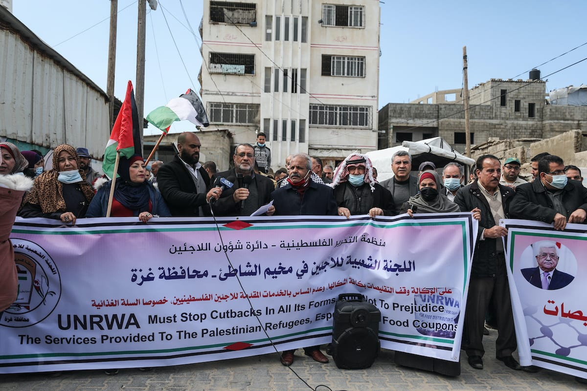 People stage a protest against cuts of aid by the United Nations Relief and Works Agency (UNRWA) outside the UNRWA, in Gaza City, Gaza on 21 February 2021. [Mustafa Hassona - Anadolu Agency]