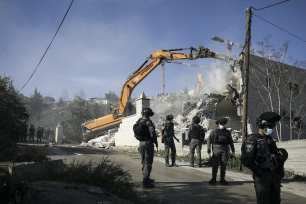 A view of the site as the Israeli-run Jerusalem Municipality team along with Israeli police and bulldozers demolishing the two-story apartment building owned by Fadi Ali Oleyyan, the head of the security department at the Al-Aqsa Mosque, near the al-Issawiya neighborhood claiming that it was unlicensed, in East Jerusalem on 22 February 2021. [Mostafa Alkharouf - Anadolu Agency]