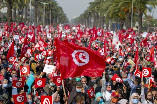 Supporters of Ennahda Movement rally to demand the end of political crisis in the country as the cabinet revision issue between President of Tunisia, Kais Saied and Prime Minister of Tunisia, Hichem Mechichi continues in Tunis, Tunisia, on 27 February 2021. [Yassine Gaidi - Anadolu Agency]
