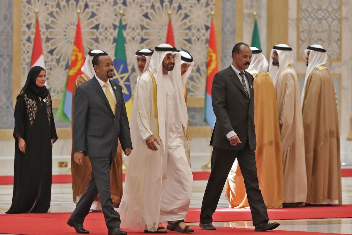 Abu Dhabi's Crown Prince Sheikh Mohamed bin Zayed Al Nahyan (C) receives Ethiopian Prime Minister Abiy Ahmed (L) and Eritrean President Isaias Afwerki (R) at the presidential palace in the UAE capital Abu Dhabi on 24 July 2018. [KARIM SAHIB/AFP via Getty Images]