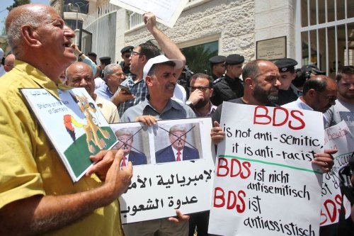 Protesters stage a demonstration outside Germany's Representative Office in Ramallah in the Palestinian West Bank on 22 May 2019, following the Bundestag's (German parliament) condemnation of the Boycott, Divestment, Sanctions (BDS) movement as anti-Semitic. [AFP via Getty Images]
