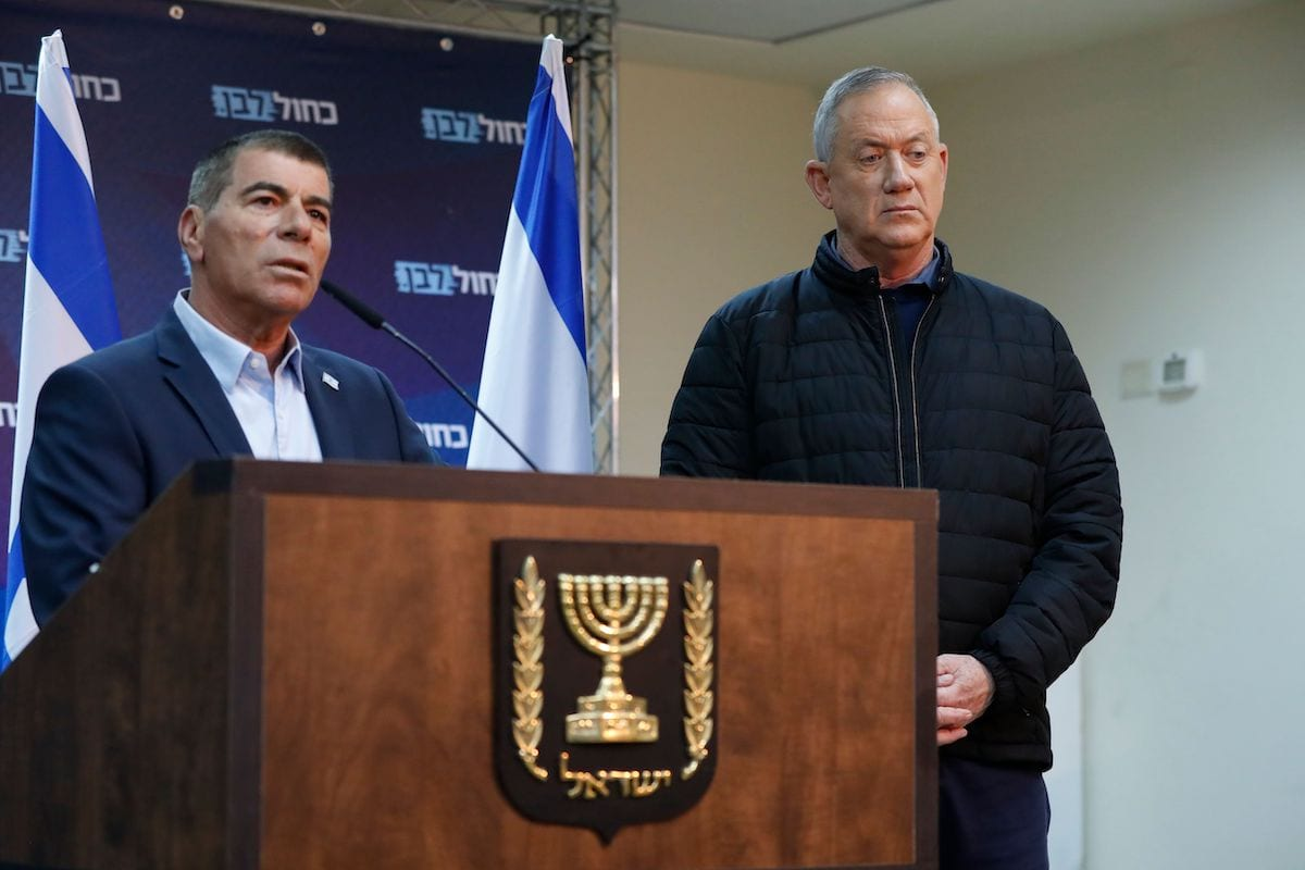Leader of Israel's Blue and White electoral alliance Benny Gantz listens to Gabi Ashkenazi, a member of the Blue and White electoral alliance, speaking during a press conference in the southern Israeli town of Sderot on the border with Gaza on 24 February 2020. [JACK GUEZ/AFP via Getty Images]