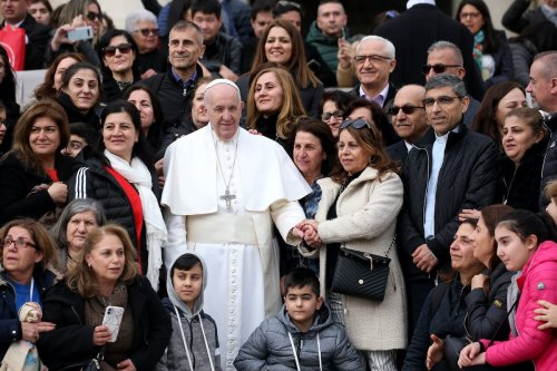 Pope Francis poses with faithful from Iraq in St. Peter's Square during his weekly audience on 26 February 2020 in Vatican City, Vatican. [Franco Origlia/Getty Images]