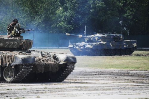 Leopard 2/A4 battle tanks are seen during a handover ceremony of tanks at the army base of Tata, Hungary, on 24 July 2020. [ATTILA KISBENEDEK/AFP via Getty Images]