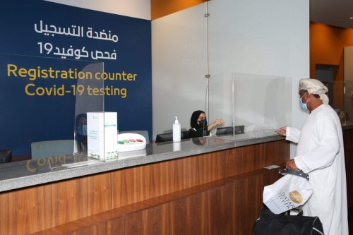 A passenger, wearing a protective face mask due to the Covid-19 pandemic, checks-in at the testing counter at the Muscat international airport in the Omani capital on October 1, 2020. (Photo by MOHAMMED MAHJOUB / AFP) (Photo by MOHAMMED MAHJOUB/AFP via Getty Images)