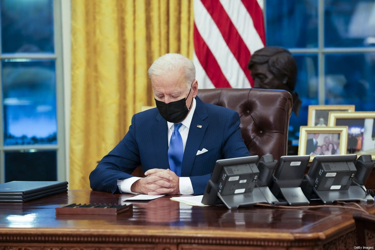 US President Joe Biden signs executive actions in the Oval Office of the White House in Washington, DC, US, on Tuesday, 2 Feb. 2021. [Doug Mills/The New York Times/Bloomberg via Getty Images]