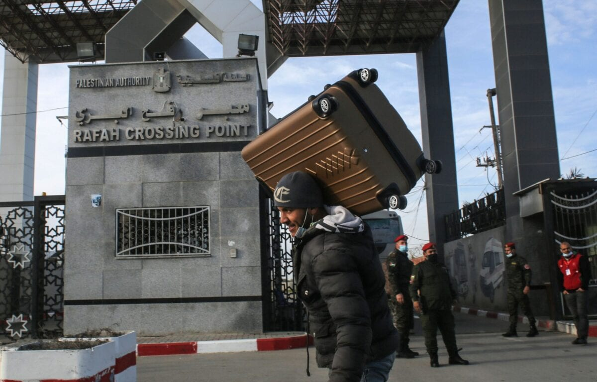 A man carries a suitcase at the Rafah border crossing with Egypt, in the southern Gaza Strip, on February 9, 2021 [SAID KHATIB/AFP via Getty Images]