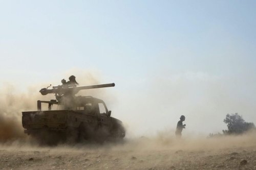 Saudi-backed government troops repel a Huthi rebel offensive on oil-rich Marib, some 120 kilometres (75 miles) east of Yemen's rebel-held capital Sanaa, on 14 February 2021. [AFP via Getty Images]