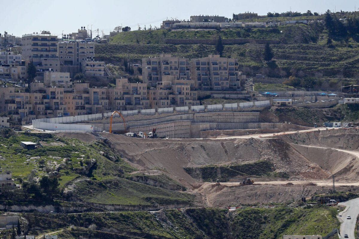 A view of ongoing construction work at Nof Zion, a Jewish settlement in the Israeli-annexed eastern sector of Jerusalem on February 16, 2021 [AHMAD GHARABLI/AFP via Getty Images]