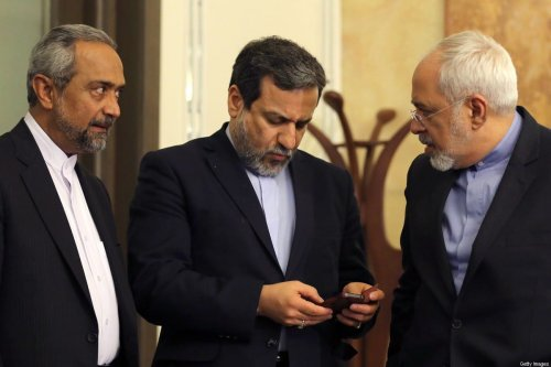 "Iranian Foreign Minister Javad Zarif (R), deputy Foreign Minister and chief nuclear negotiator Abbas Araghchi (C) and deputy Foreign Minister for European and American Affairs Majid Takht-Ravanchi (L) talk during a press conference of President Hassan Rouhani (unseen) in Tehran on April 3, 2015. Iran vowed to stand by a nuclear deal with world powers as Rouhani promised it would open a ""new page"" in the country's global ties. AFP PHOTO/ATTA KENARE (Photo credit should read ATTA KENARE/AFP via Getty Images)"