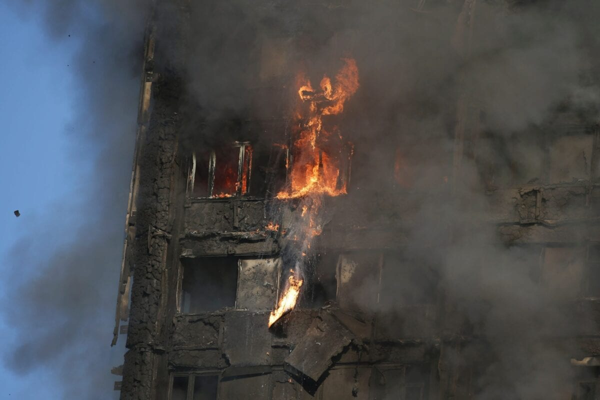 """TOPSHOT - Fire rips through Grenfell Tower as firefighters attempt to control a huge blaze on June 14, 2017 in west London. The massive fire ripped through the 27-storey apartment block in west London in the early hours of Wednesday, trapping residents inside as 200 firefighters battled the blaze. Police and fire services attempted to evacuate the concrete block and said """"a number of people are being treated for a range of injuries"""", including at least two for smoke inhalation. / AFP PHOTO / Daniel LEAL-OLIVAS (Photo credit should read DANIEL LEAL-OLIVAS/AFP via Getty Images)"""