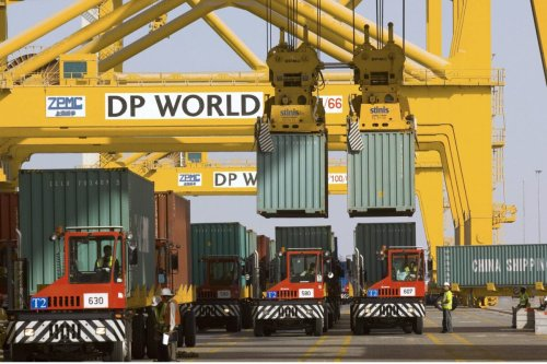 Containers seen being offloaded at the DP World operated Jebel Ali Port, in Dubai, United Arab Emirates, on December 26, 2007 [Charles Crowell/Bloomberg via Getty Images]