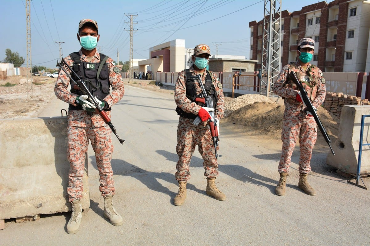 Soldiers stand guard at the Pakistan-Iran border on 17 March 2020 [SHAHID ALI/AFP/Getty Images]