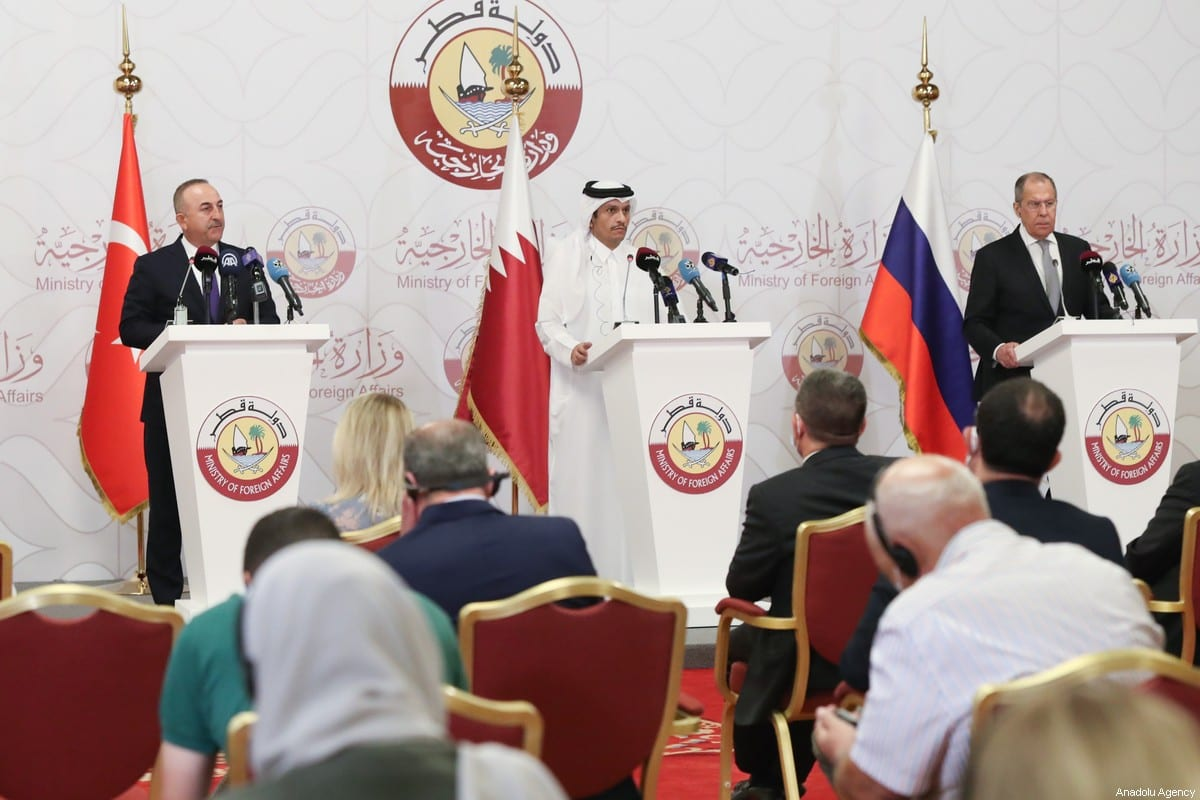 Turkish Foreign Minister Mevlut Cavusoglu (L), Qatari Minister of Foreign Affairs Mohammed bin Abdulrahman Al-Thani (C) and Russian Foreign Minister Sergey Lavrov in Doha, Qatar on 11 March 2021 [Cem Özdel/Anadolu Agency]